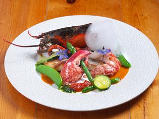 『活けオマール海老と鮮魚のポアレ 海のエキュム添え』