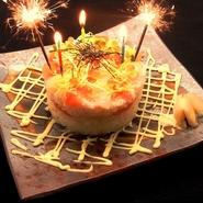 お誕生日特典、ロウソクに炎を灯し、まるで本物のケーキのような評判の寿司。お誕生日の祝いに大変人気。(※証明できるものをご持参下さい。前後1週間有効。)なんと金曜日もOK、他券併用不可。