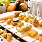 厳選食材をつかった串カツを、たっぷりと味わえる【串の坊】のおまかせコース。そのメニューの豊富さに、驚かされることでしょう。今日は何の串が味わえるのかと、楽しみも広がります。串カツ16種で5000円相当。
