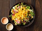 シーザードレッシングと明太子の味わいが旬の野菜を引き立てます。トッピングは九州のサツマイモ。