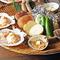 新鮮な魚貝、野菜、国産和牛を炭火焼きでお愉しみください。