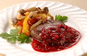 Beef steak with cranberry sauce