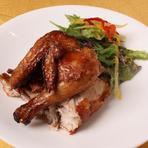 一羽丸ごと油をかけて唐揚げにした名物料理『天津チキン』