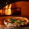 美味しい本格ピザの秘密は、愛情がこもったピザ釜