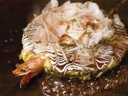 海鮮、豚肉、牛肉が入った豪華な一枚『千房焼』