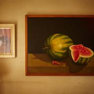 絵画や時計などのスイカをモチーフにした調度品の多くは、シェフのスイカ好きを知る常連からのプレゼント。