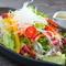 新鮮な11種類の野菜を、野菜から作ったオリジナルドレッシングで『葡萄屋サラダ』