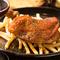 店長山中の故郷香川県の新名物骨付き鶏を洋風にアレンジした『骨付 国産鶏もも肉 スパイス焼』