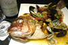 主賓へのサプライズとして真鯛を一尾まるごと使用したアクアパッツァ歓送迎会コース(全6品)