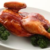えも言われぬ食感とジューシーな味の看板料理「但馬鶏の丸焼き」