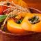 季節感を柿の器で『ほうれん草とウニの和え物』