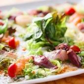 ボリューム満点の新鮮な魚介類『ペッシェのカルパッチョ』