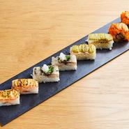 炙り+デリシャス=アブリシャス ・サーモンとアイオリソースの炙り押し寿司 ・えびとバジルソースの炙り押し寿司 ・シメ鯖と西京味噌の炙り押し寿司 ・雲丹と蟹とサーモンととびっこのKINKAロール