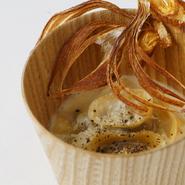 ふきのとうのラビオリ新玉ねぎのクリームソース