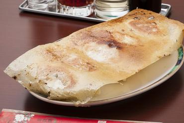 大きな羽根にモチモチの皮、たっぷりの肉汁が魅力的『焼き餃子』