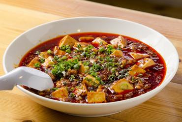 『四川麻婆豆腐』は四川から仕入れる山椒と花椒を使った本場の味
