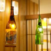 「キャノラインジーンズ」や「東北の地酒瓶」がインテリア