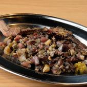 炭の煤で表面を真っ黒に焼きあげた、宮崎を代表する鶏料理といえば『もも焼きバラシ』