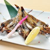地物の新鮮な魚を店内で一夜干しに。手づくりの味が楽しめる、日本酒にピッタリの『メヒカリ開き焼き』