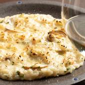 数種類の魚介類とパルミジャーノレッジャーノをふんだんに使った、深い味わいの『魚介のクリームリゾット』